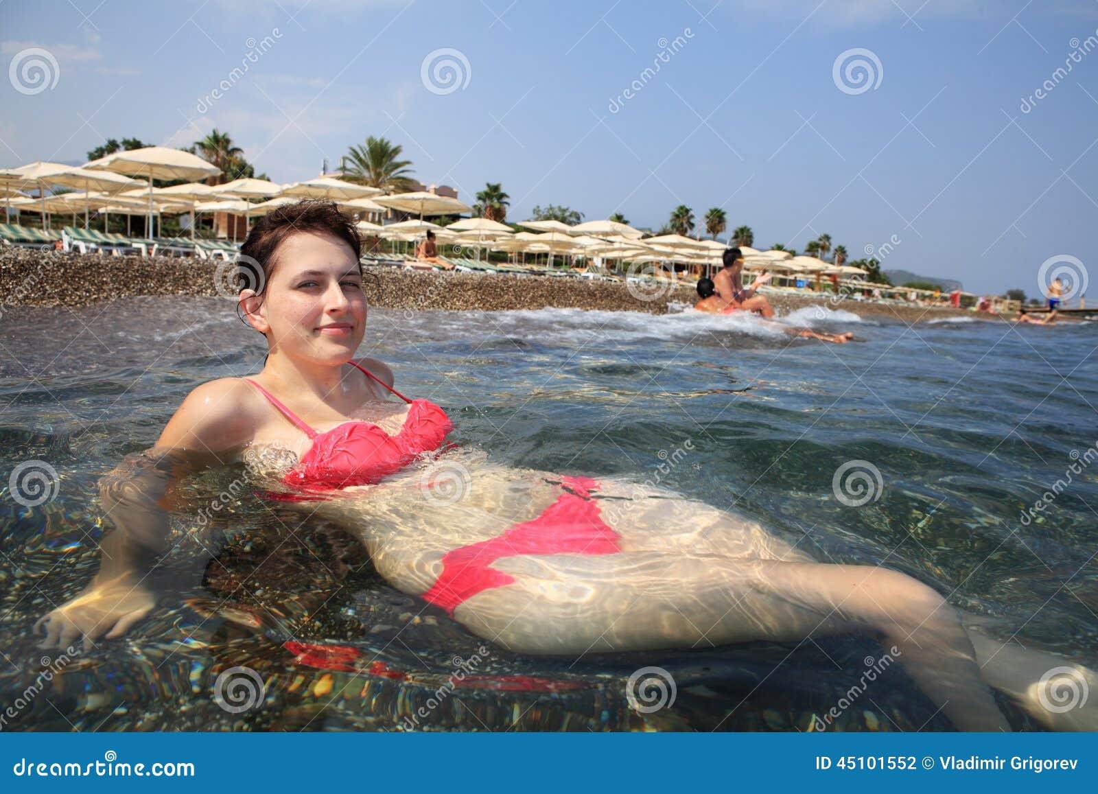 Girl Lying In Surf Mediterranean Sea, Background Of Beach ...