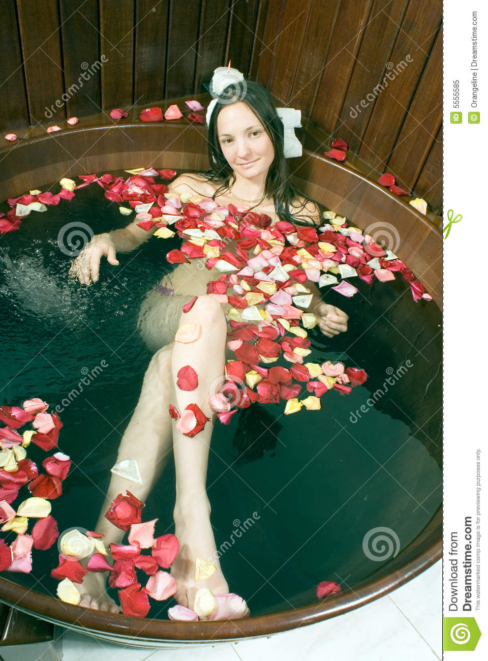 Girl Lying In Tub Of Water Vertical Royalty Free Stock