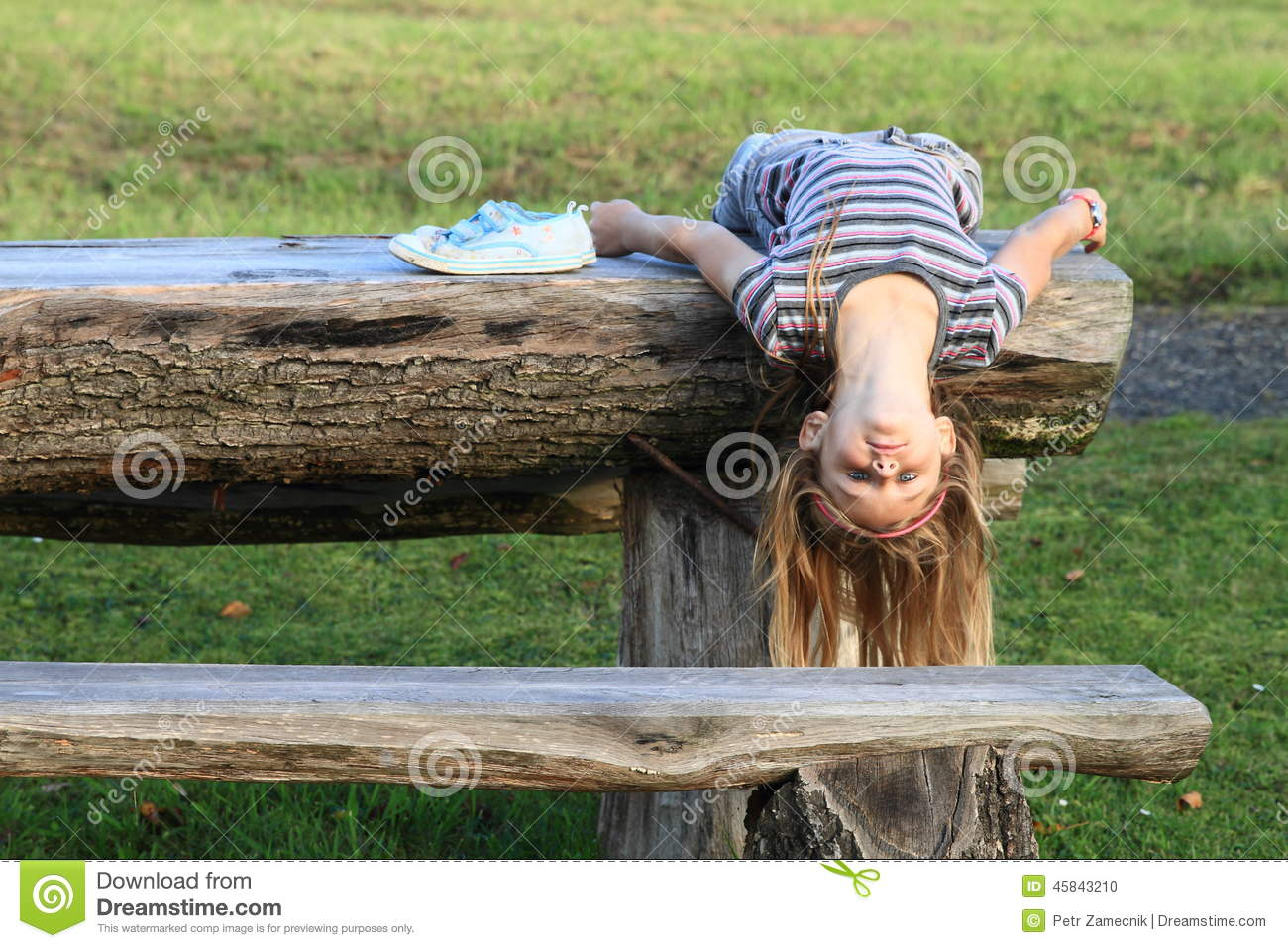 Girl Lying On Wooden Table Stock Photo Image Of Grass