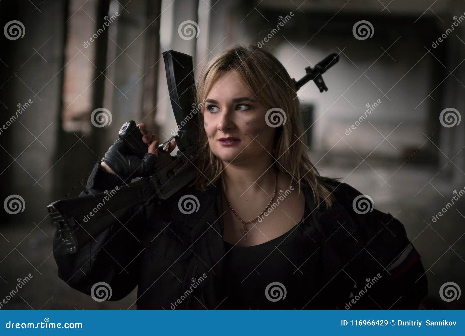 A girl with a machine gun