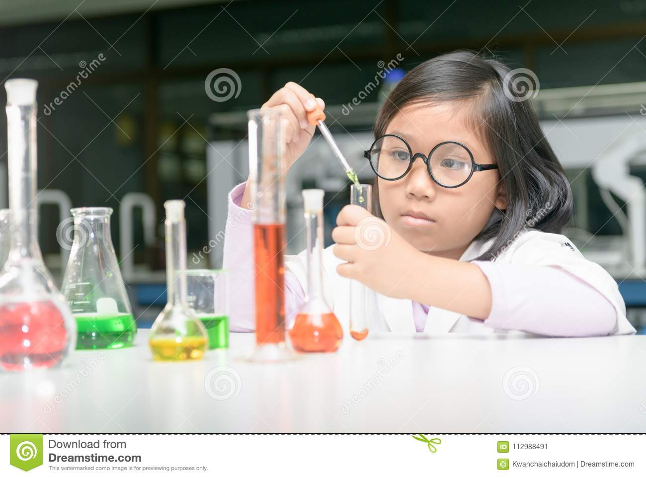 Girl making experiment with test tube