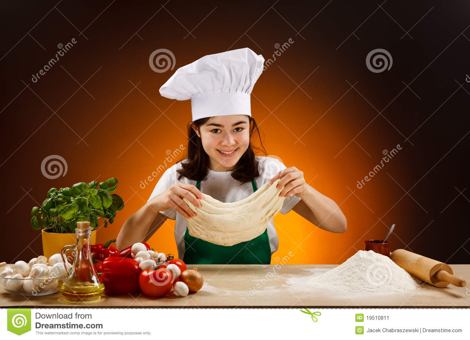 Girl making pizza dough