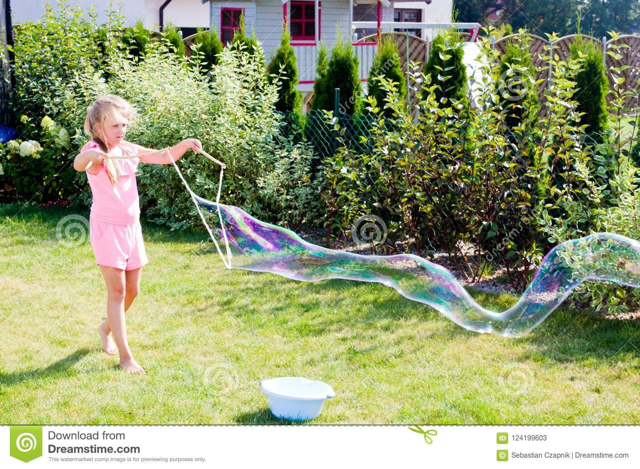 Girl Making Soap Bubbles In Home Garden Stock Image Image Of Nine