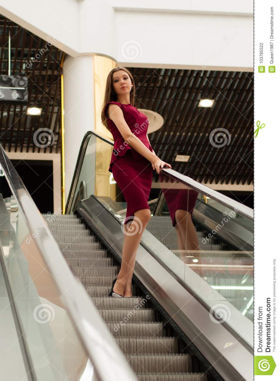 Girl In The Mall On The Escalator Stock Photo - Image of
