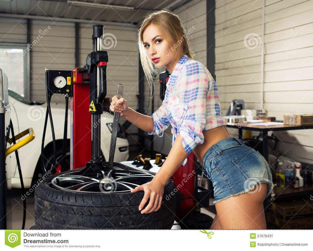girl-mechanic-replace-tires-wheels-sexy-shorts-garage-51678431.jpg