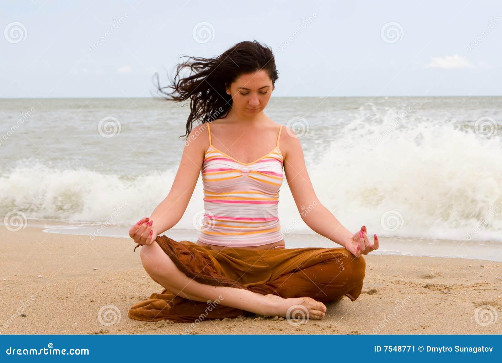 Girl meditation in beach