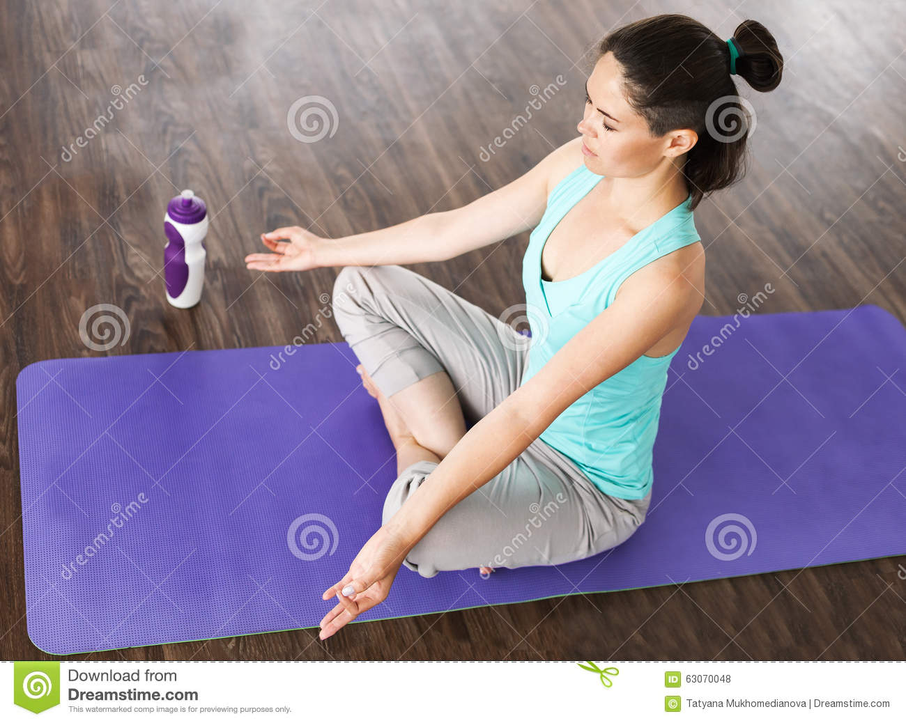 The Girl Meditation In The Lotus Position Yoga Studio
