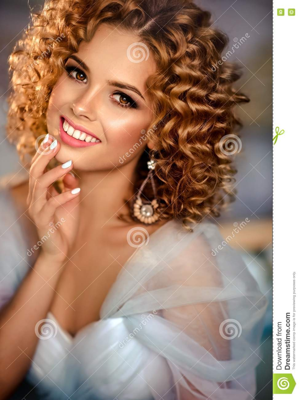 Girl Model With Dense, Curly Hair, Dressed In Evening Gown. Stock ...