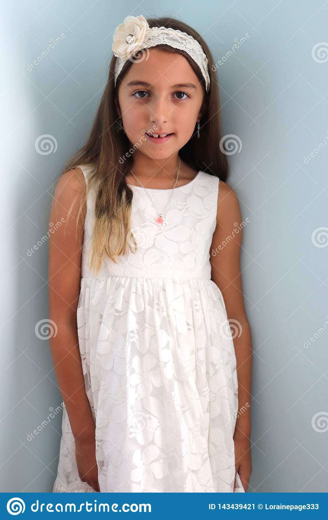 Girl Models White Dress, White Headband With Flower