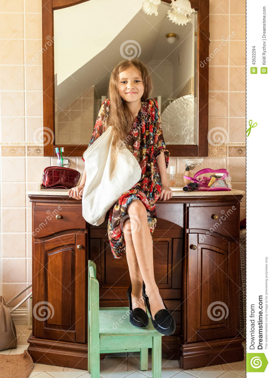 Photos of girl without any cloth in bathroom - Girl In Mothers Clothes Sitting On Sink At Bathroom
