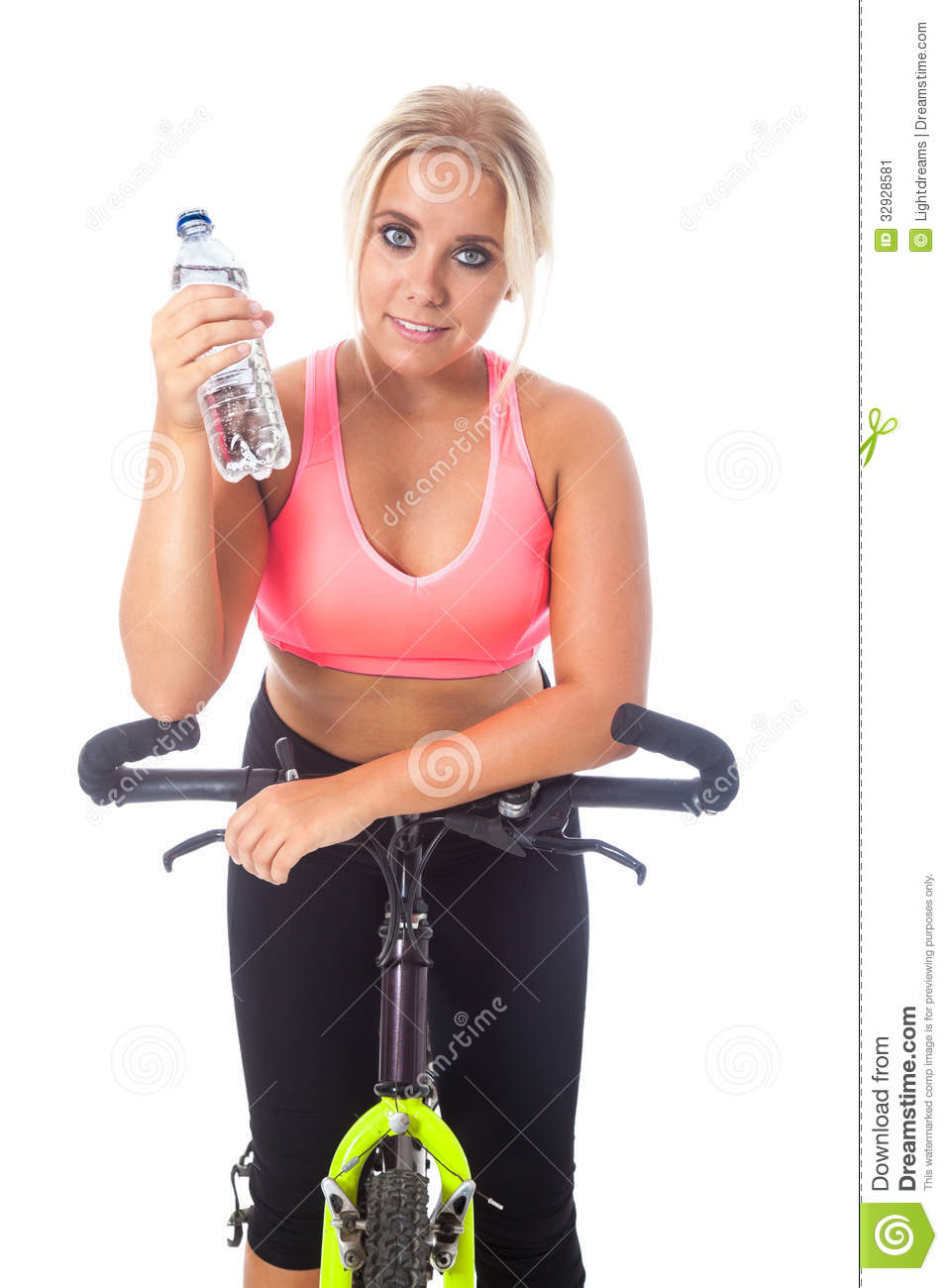Young blonde girl on a mountain bike holding a bottle of fresh ...