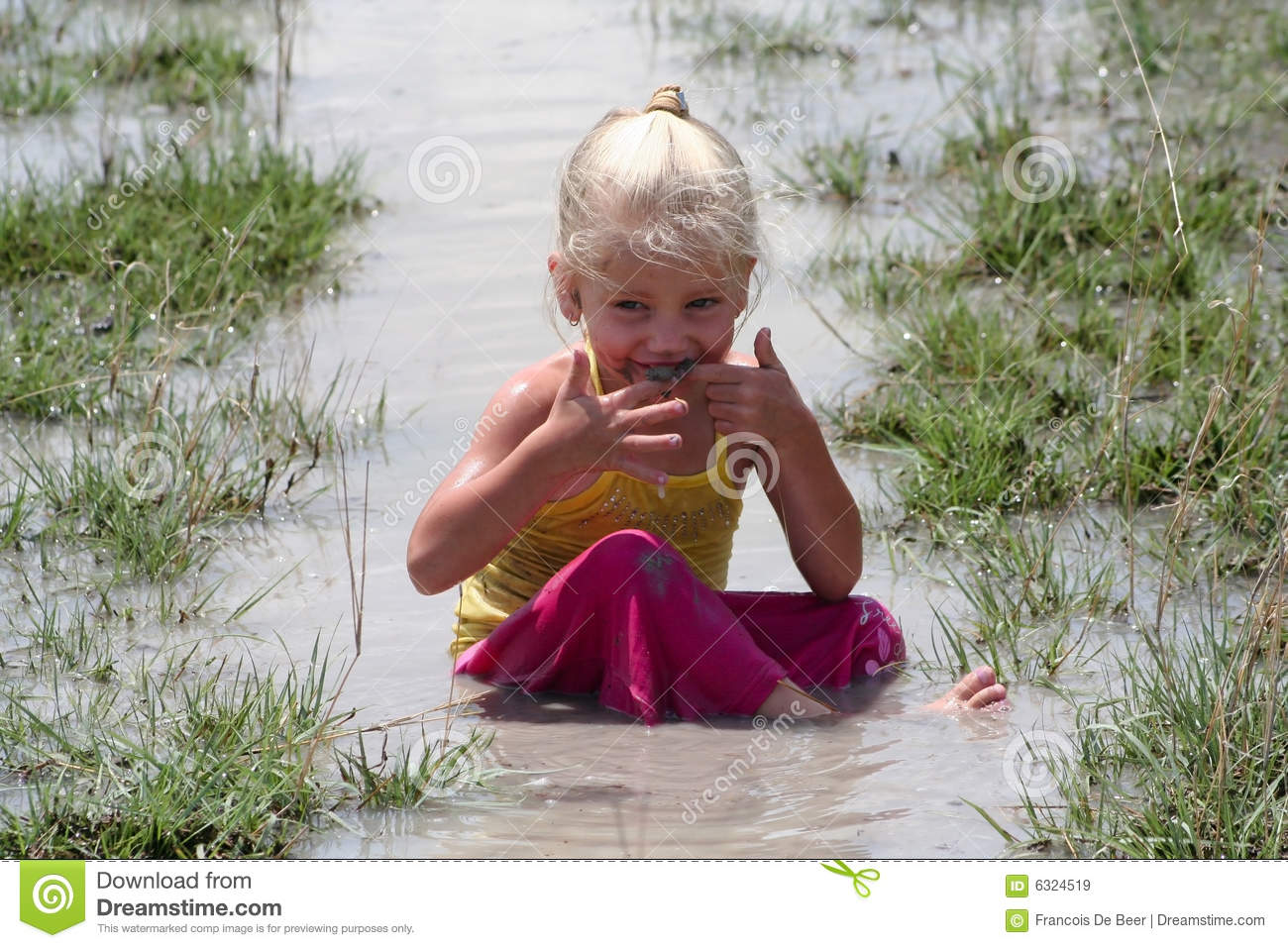 Naughty Boy And Girl Playing In Water Stock Photo - Image