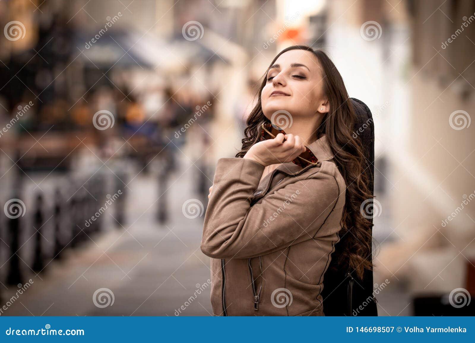 Young woman with a violin case dreams