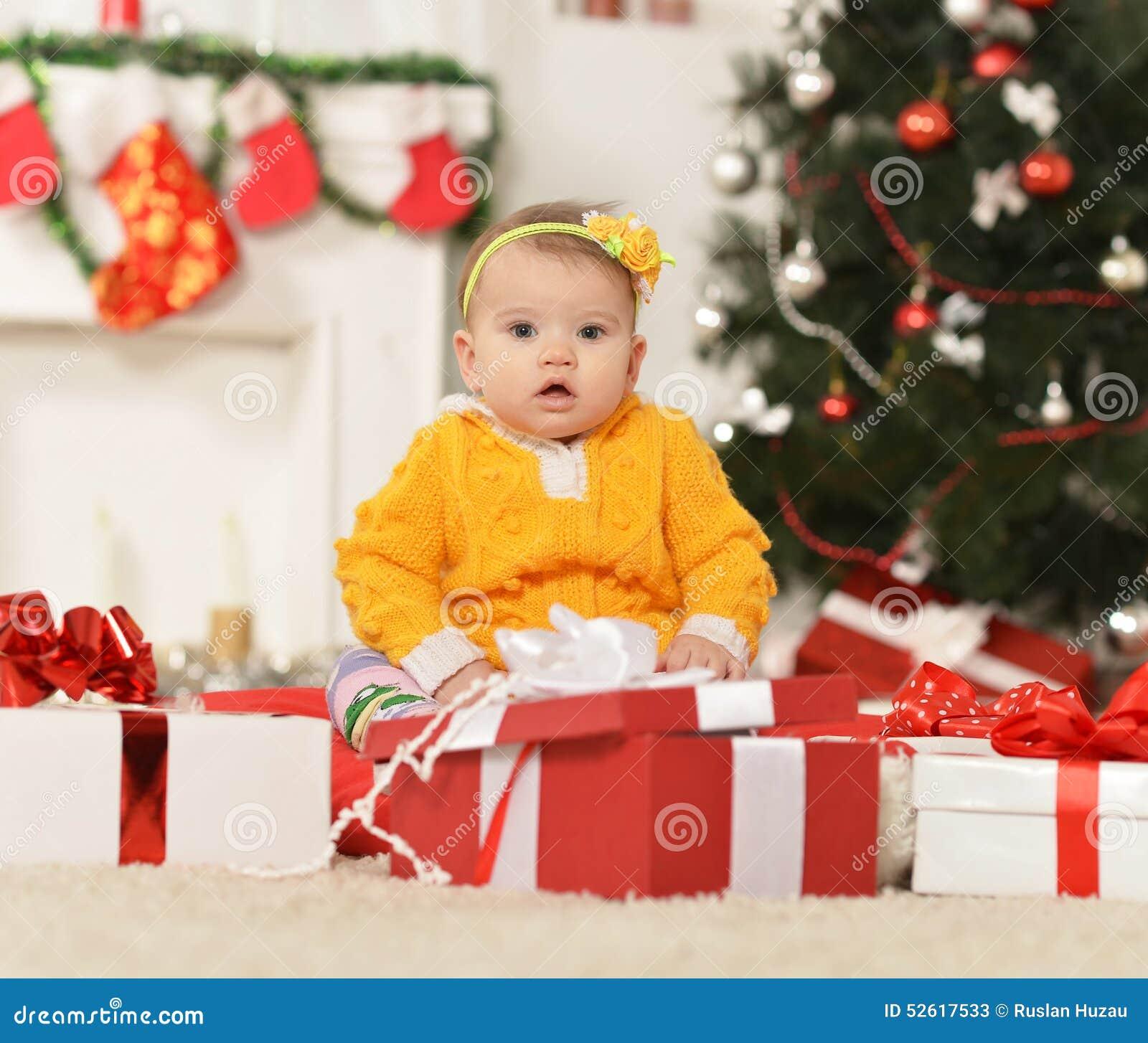 Cute Baby Gifts For Christmas : Girl near christmas tree stock photo image