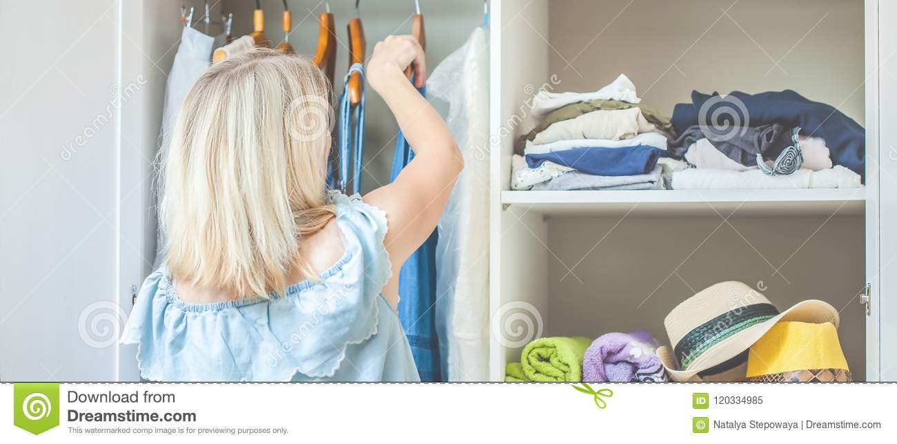 Girl near a wardrobe with clothes can not choose what to wear. Heavy Choice Concept has nothing to wear Banner