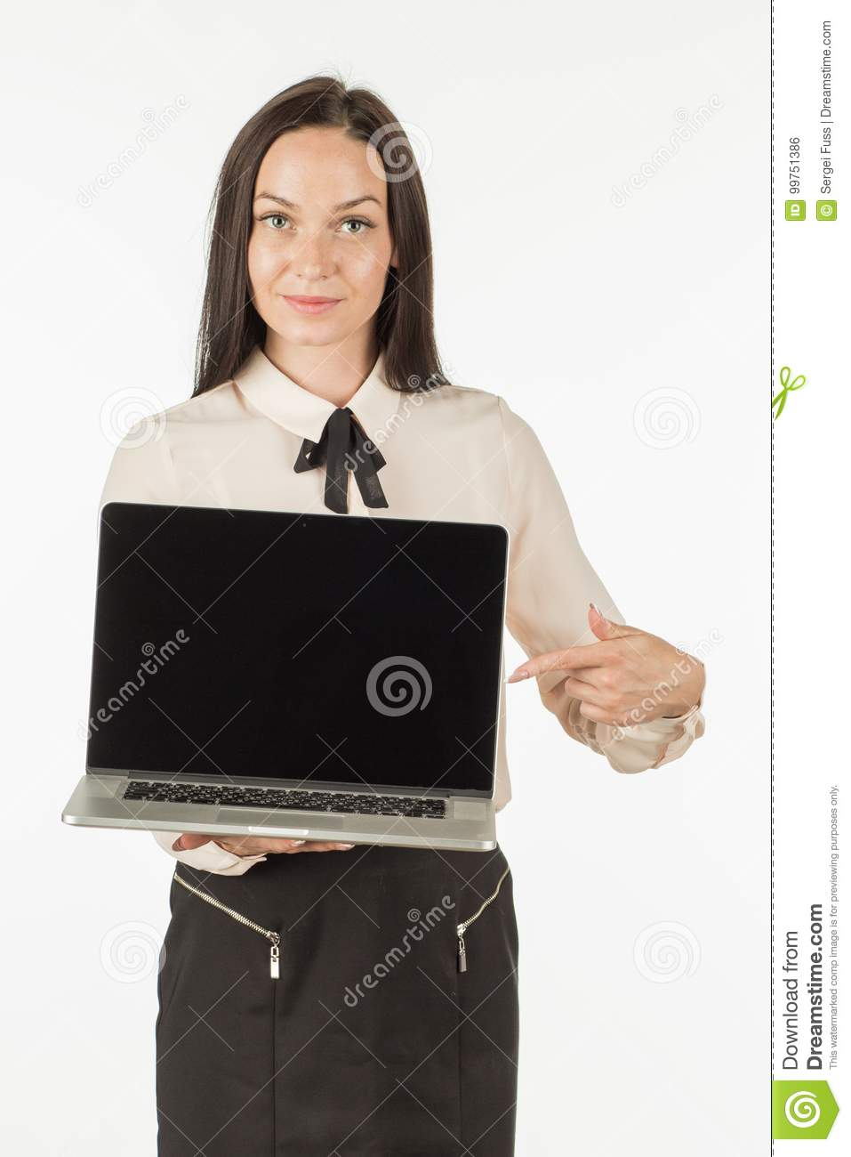A girl is offering a laptop with a smile.