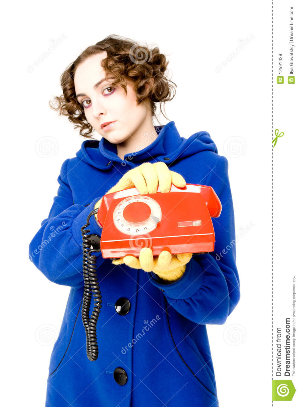 Girl with old telephone (focus on the telephone)