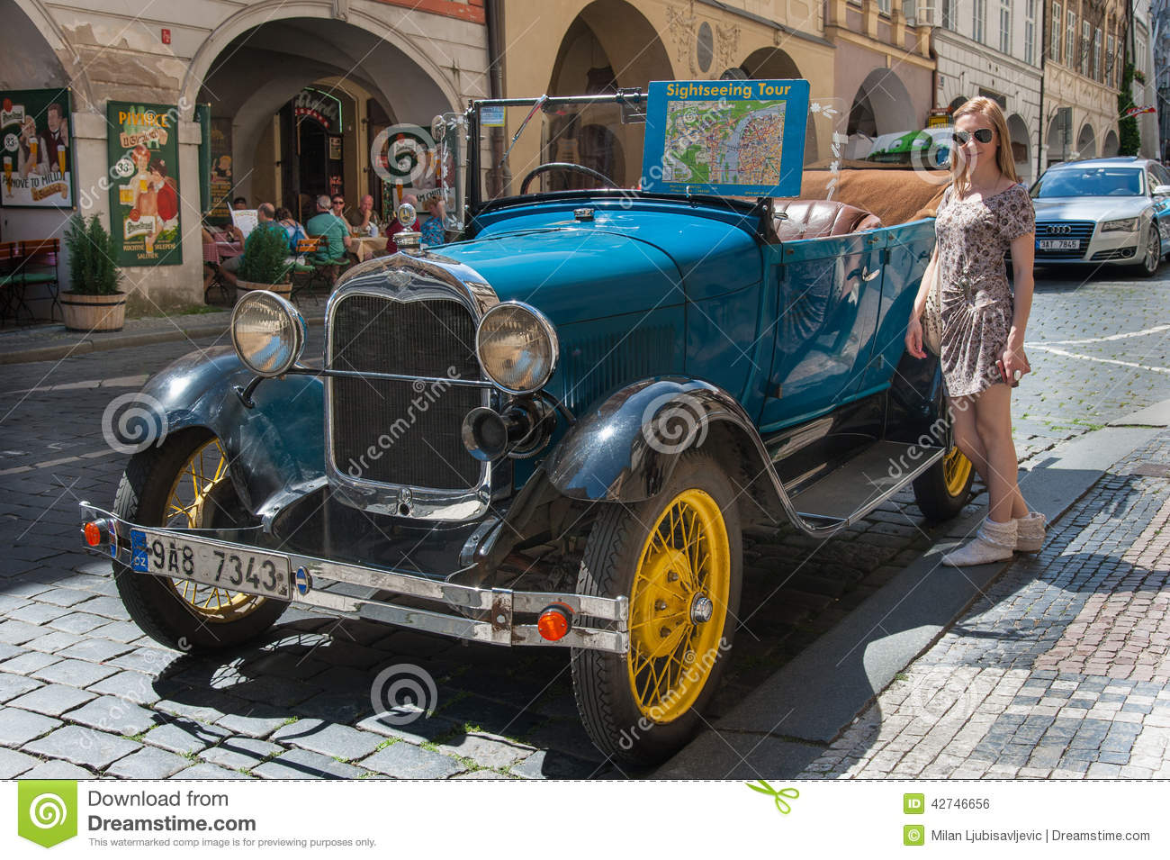 girl and oldtimer in prague streets editorial photo