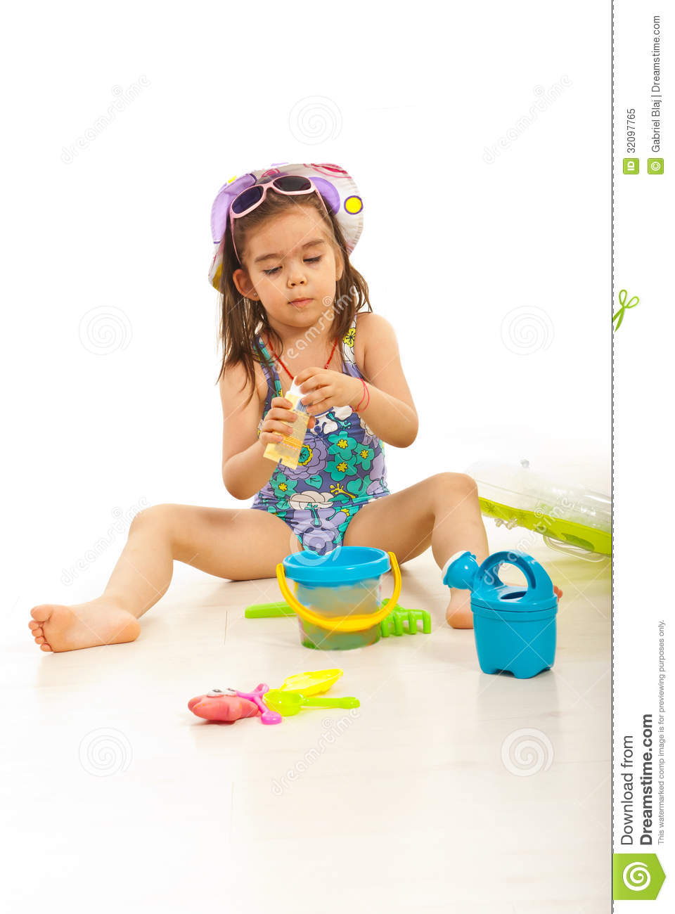 Beach Toys For Girls : Girl opening sunblock lotion royalty free stock photo