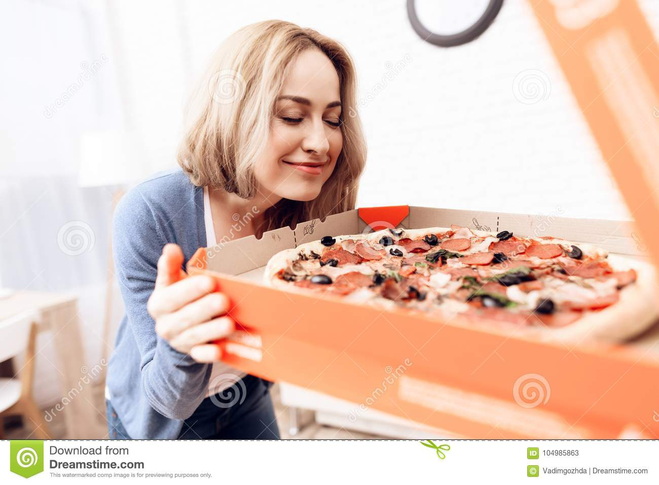The Girl Ordered The Delivery Of Pizza At Home A Young