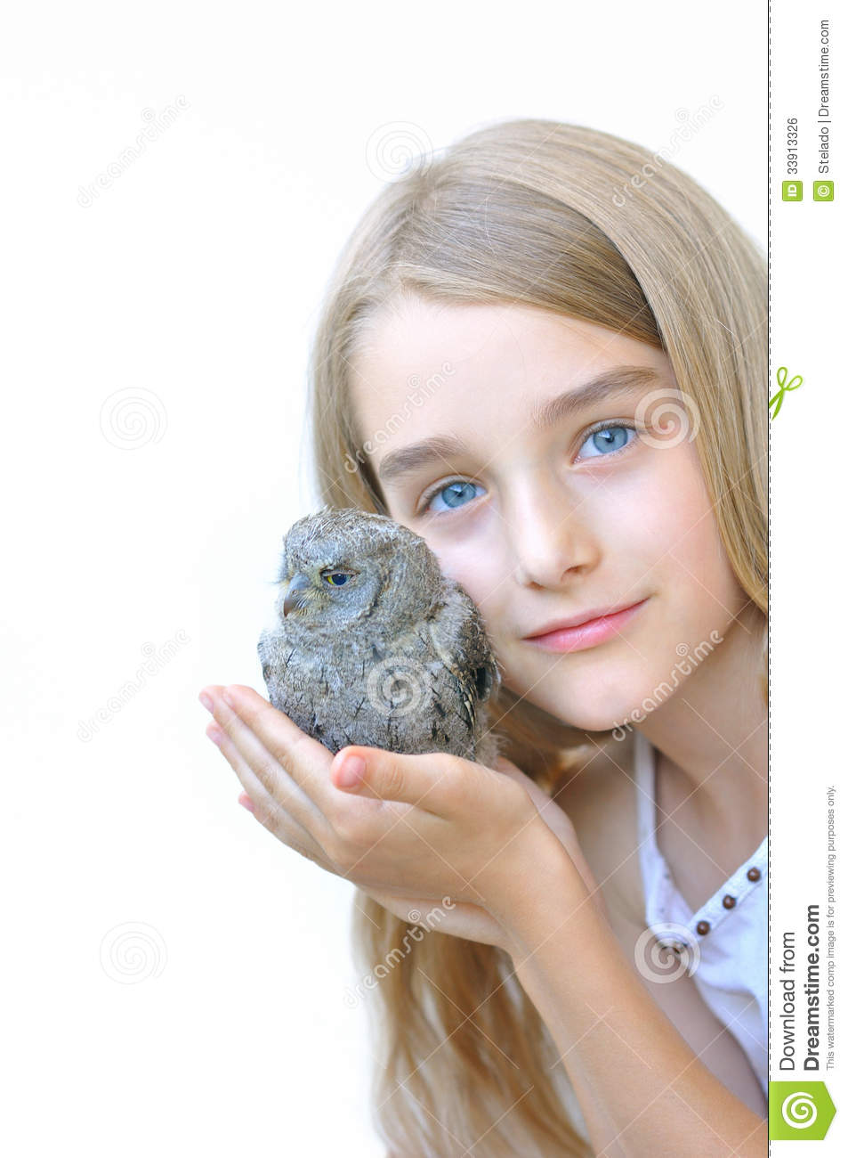 Little girl holding an owl in his hands on a white background.