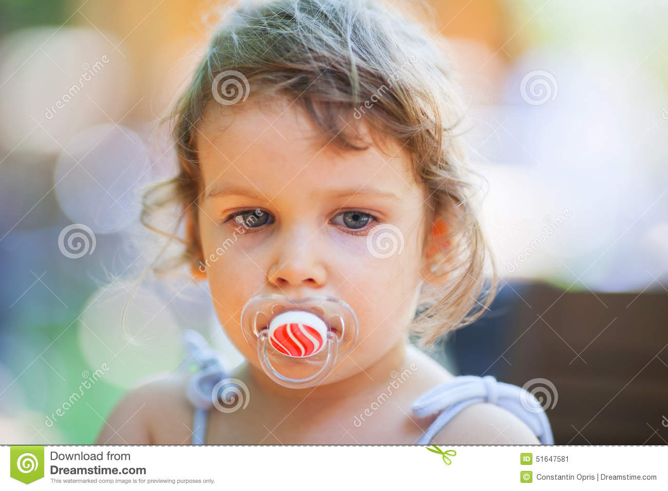 Naked women with pacifier in mouth