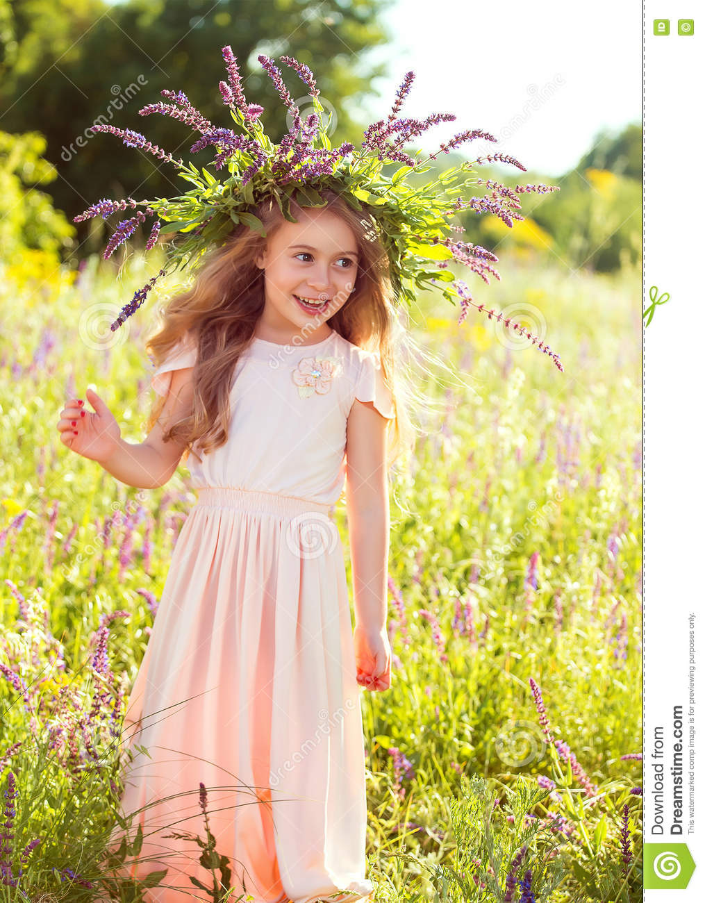 Girl in peach dress, with a wreath of wildflowers.