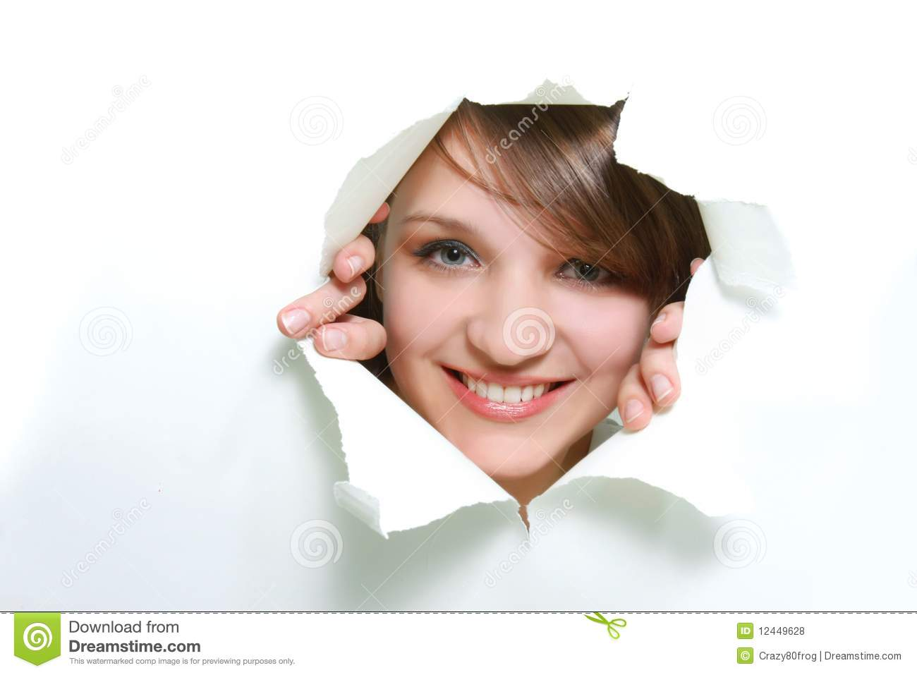 Girl peeping through hole in paper
