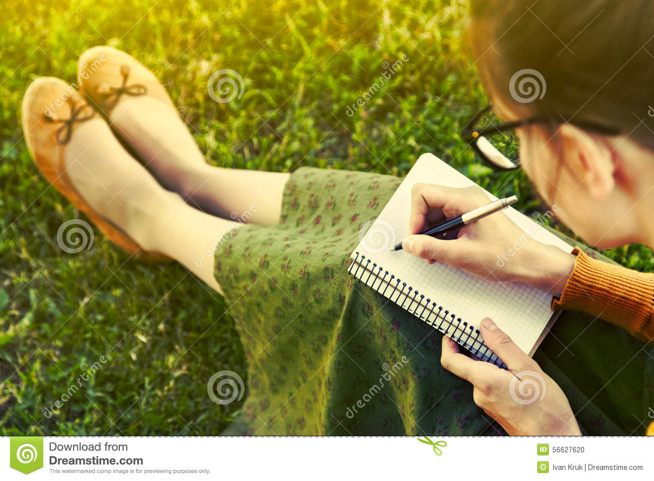 Girl with pen writing