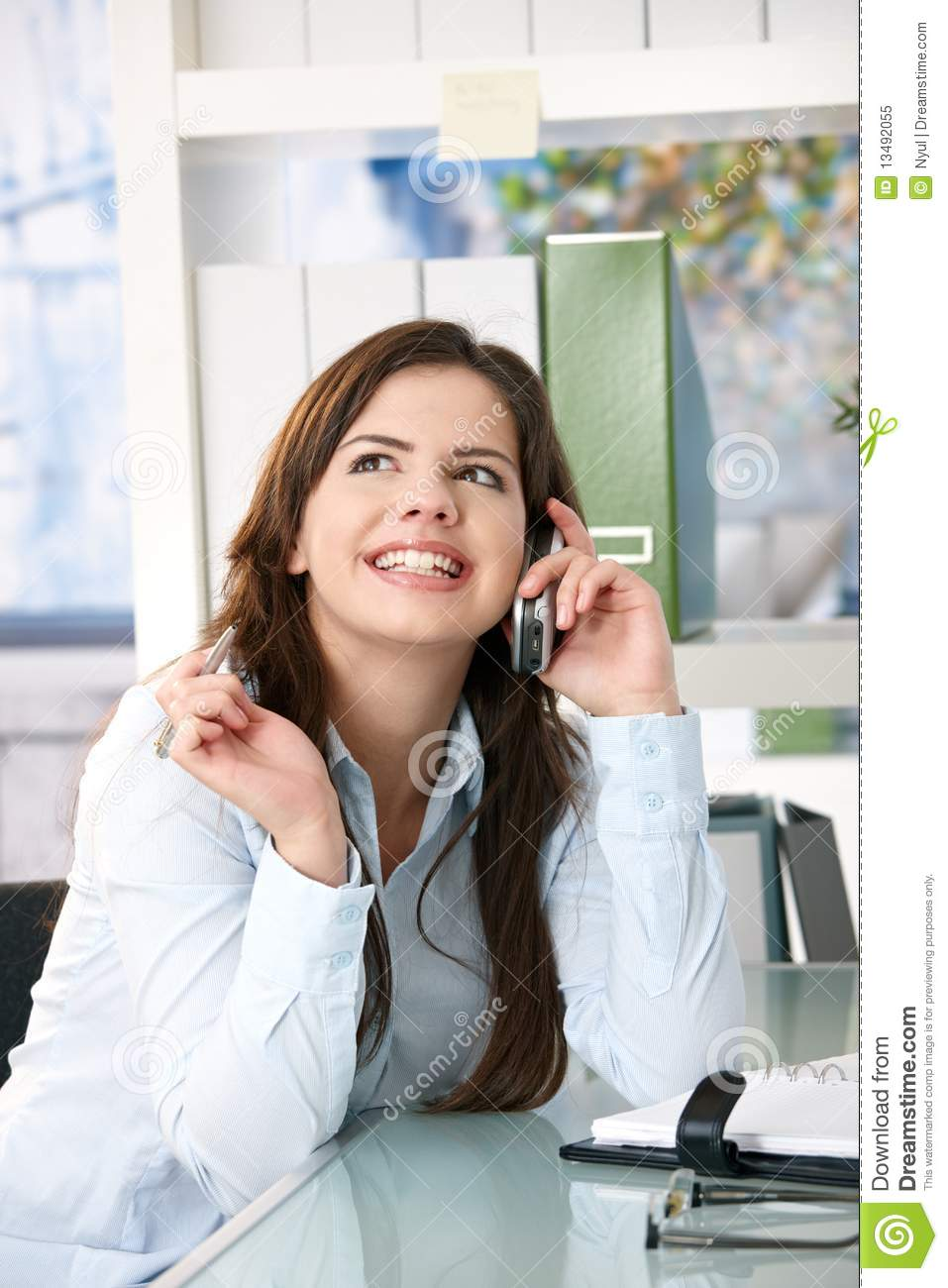 Girl On Phone Call In Office Stock Image - Image of