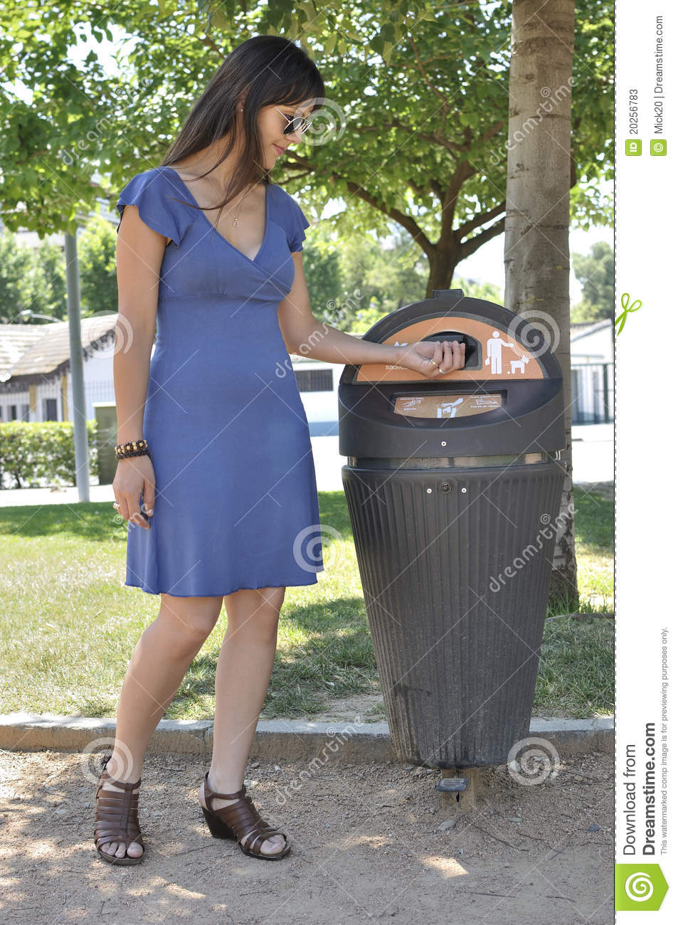 more similar stock images of girl picking up dog excrement bag in