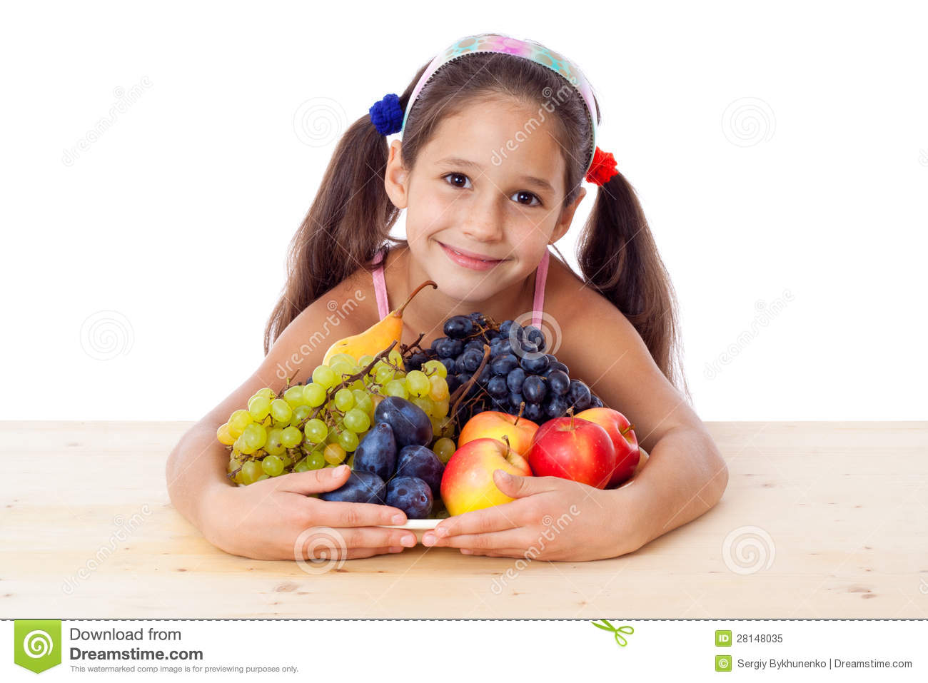 Girl with pile of fruit