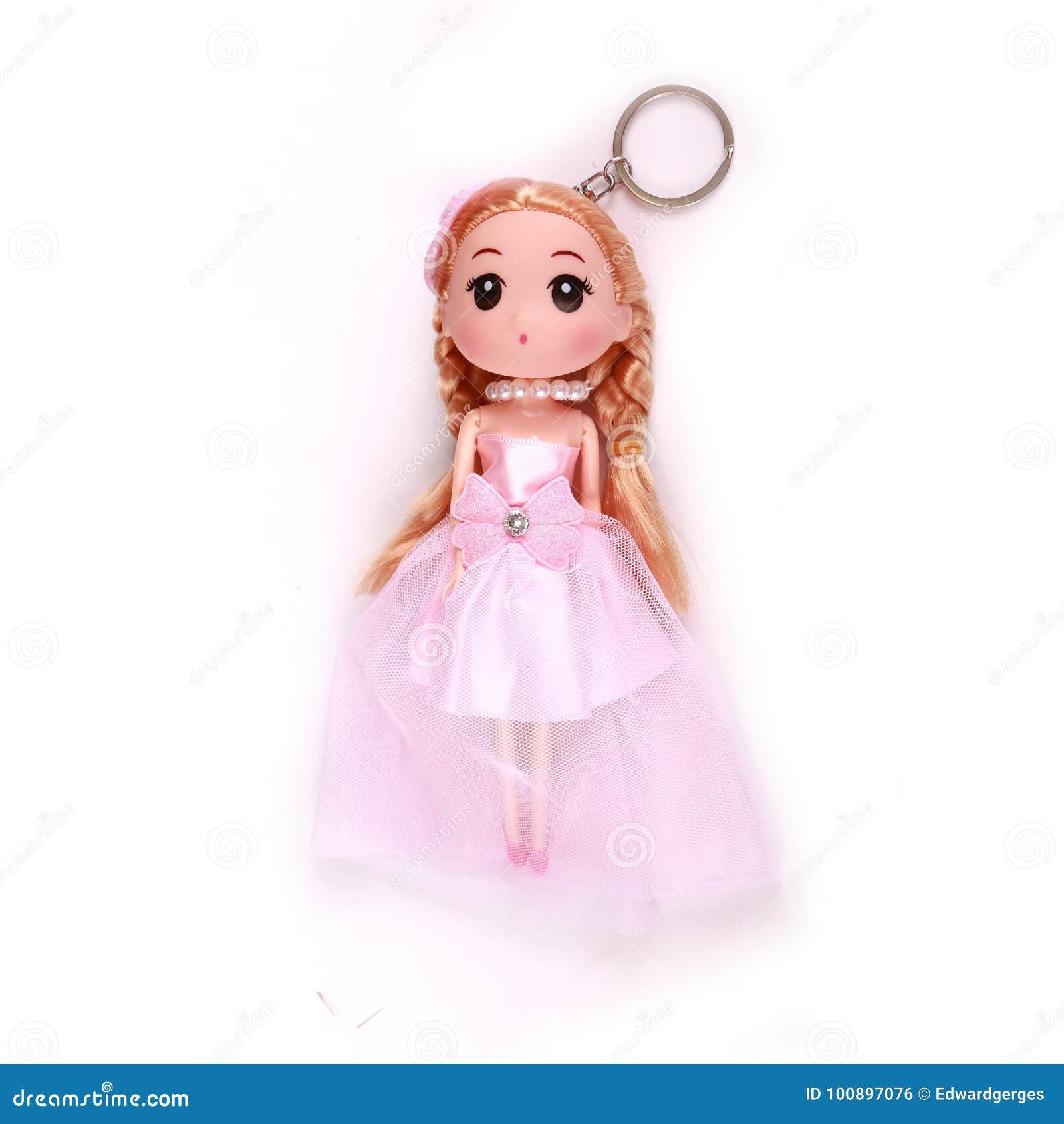 Girl pink doll medal keys stock photo. Image of christmas - 100897076