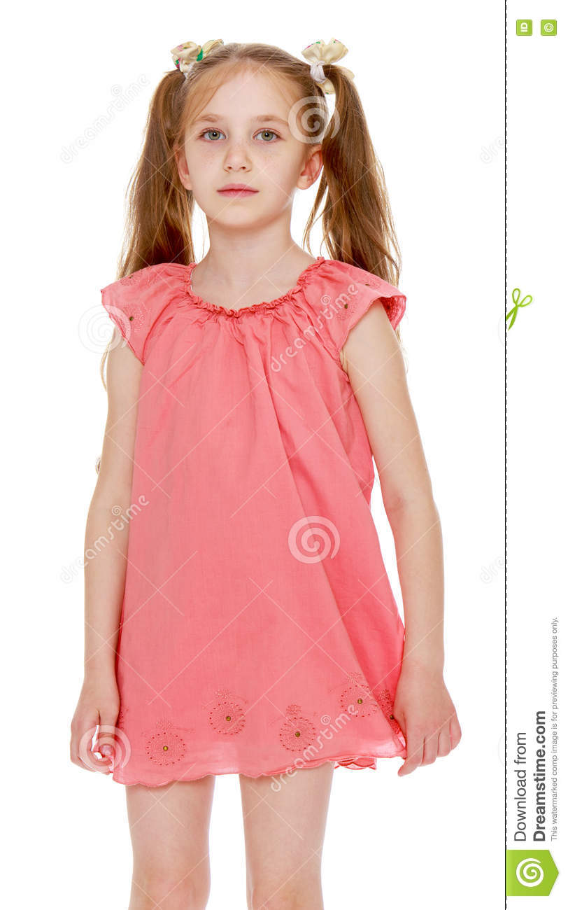 14ffde2bb0bf Sad little girl with long pigtails to her waist, braided with white  ribbons. In short pink summer dress. Close-up - on white background
