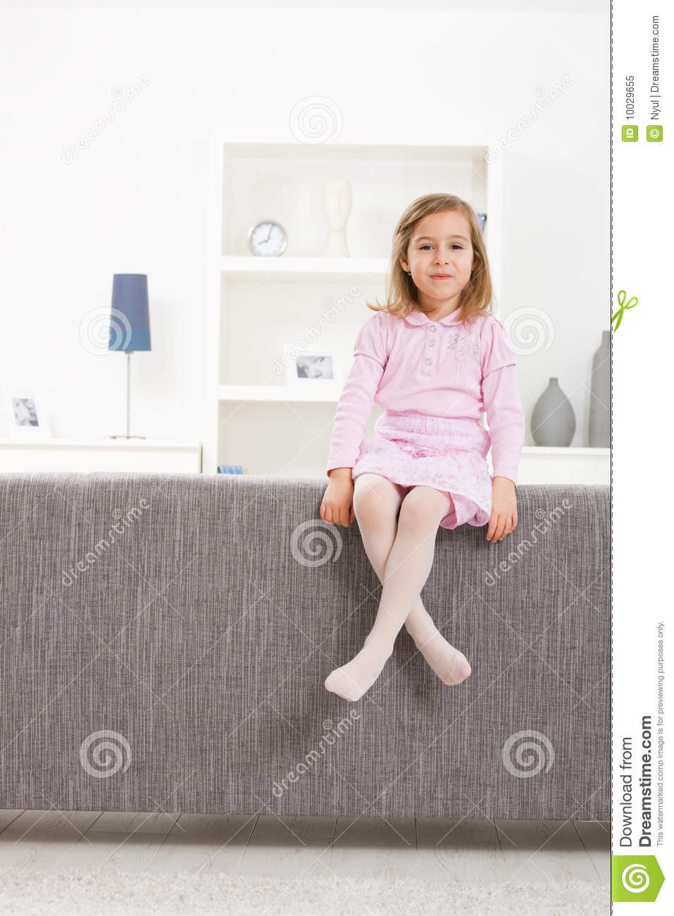 Girl In Pink Sitting On Couch Royalty Free Stock Photo