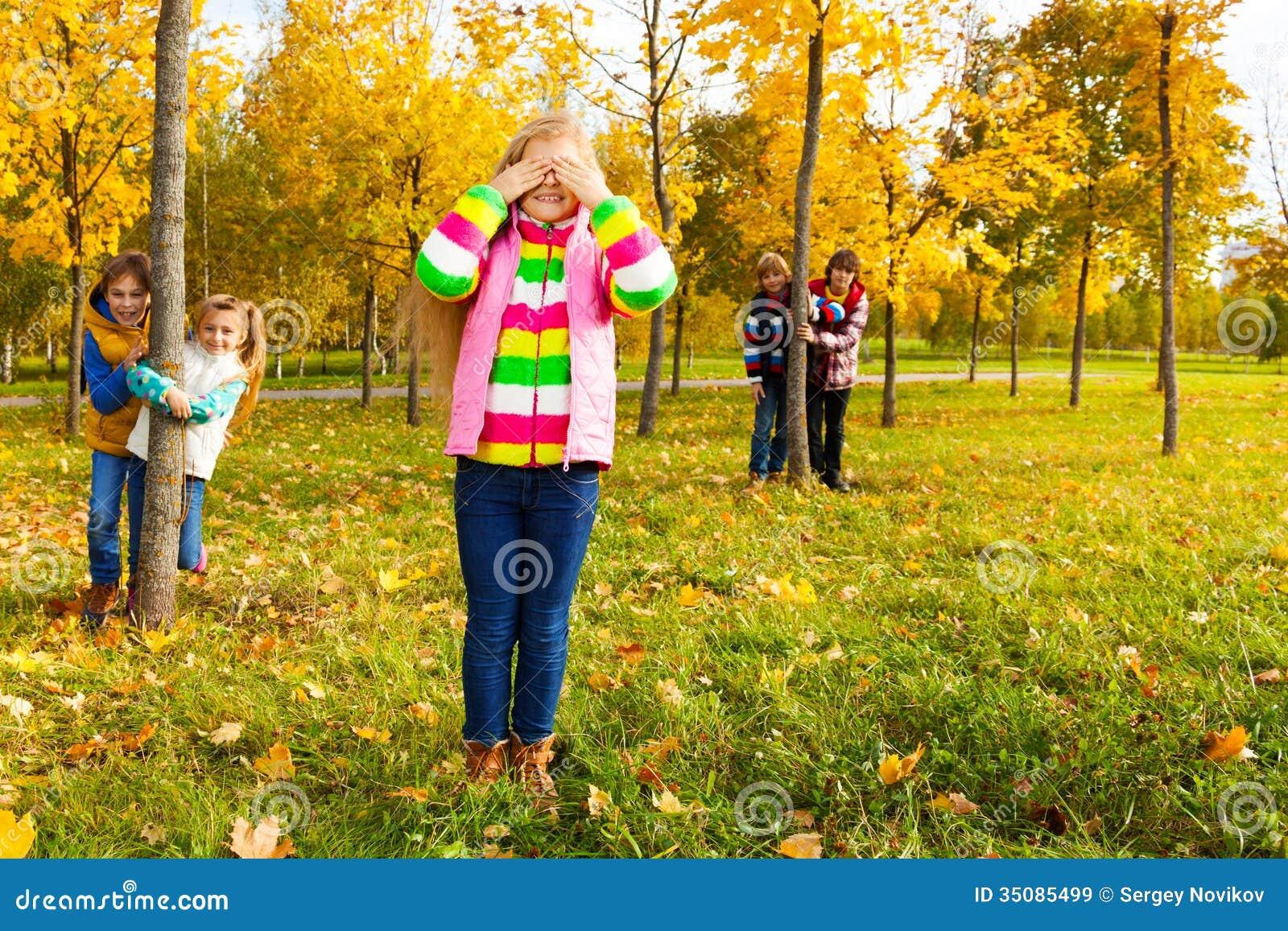 Hide Seek Kids: Girl Play Hide And Seek With Friends Royalty Free Stock