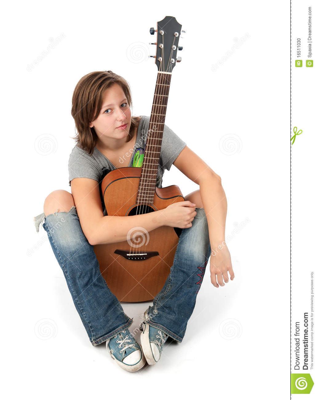 Girl Playing An Acoust...