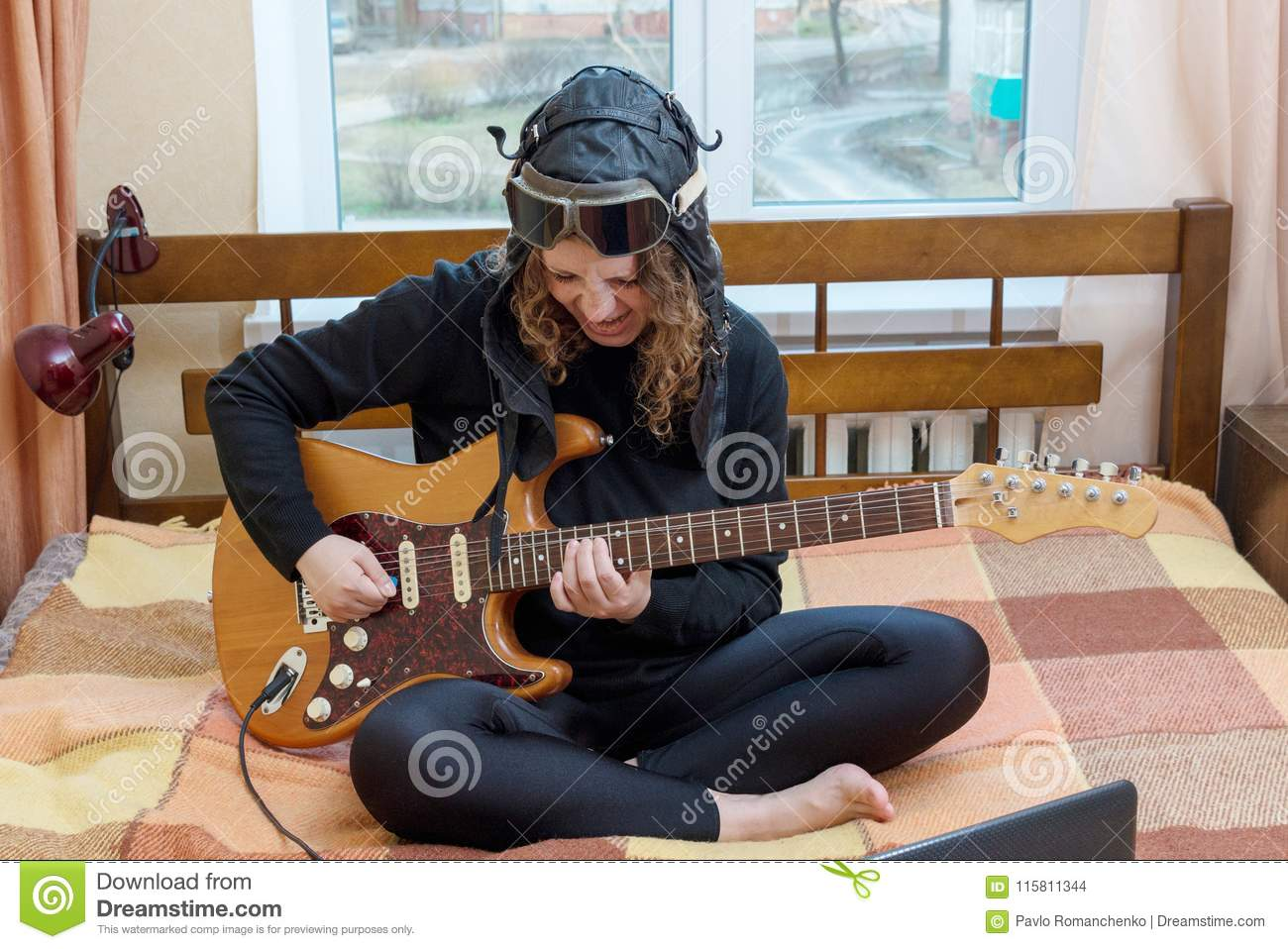 Girl Playing Electric Guitar Sitting On The Bed Stock Photo Image