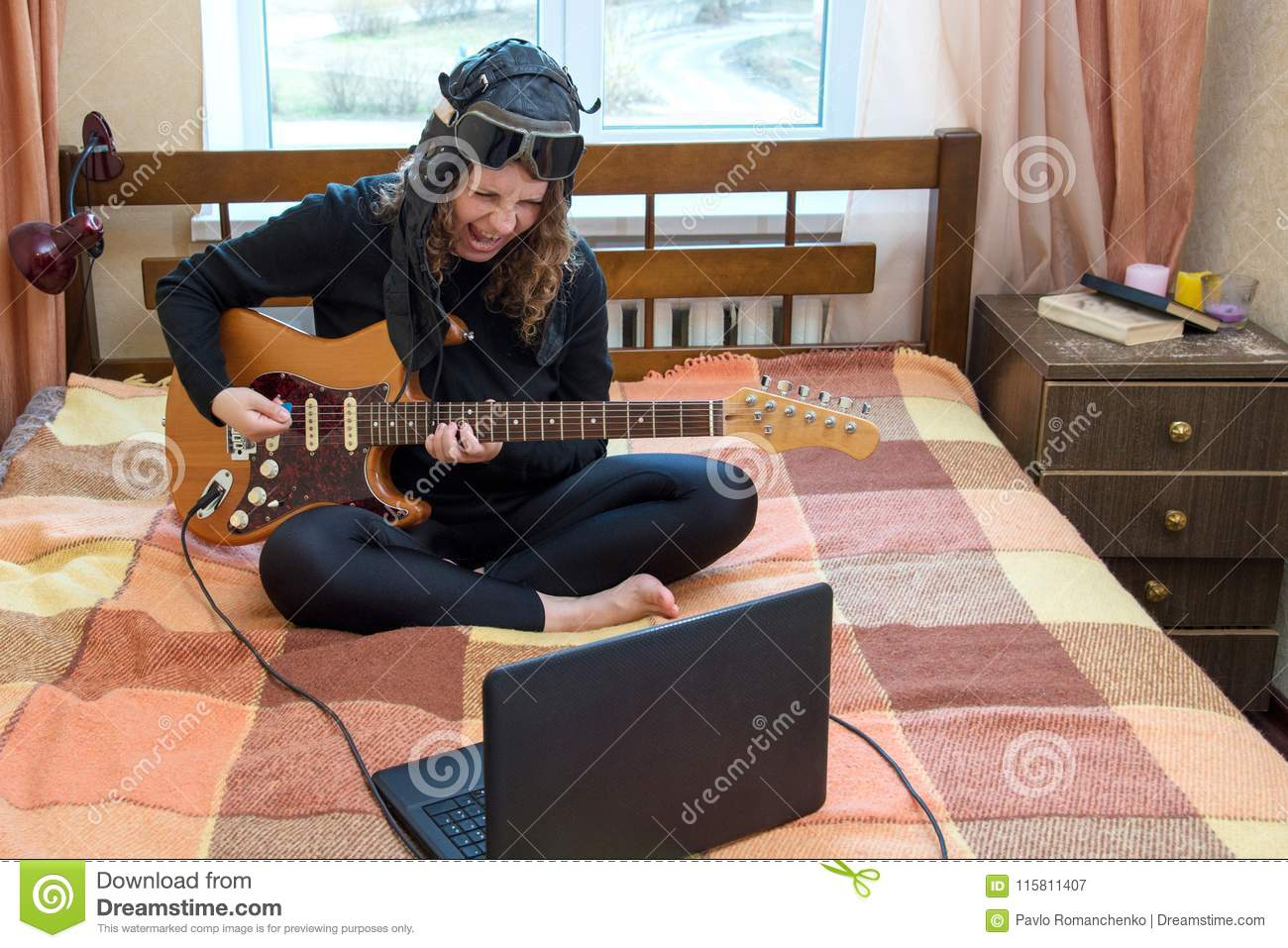 Girl Playing Electric Guitar Sitting On The Bed Stock Image Image