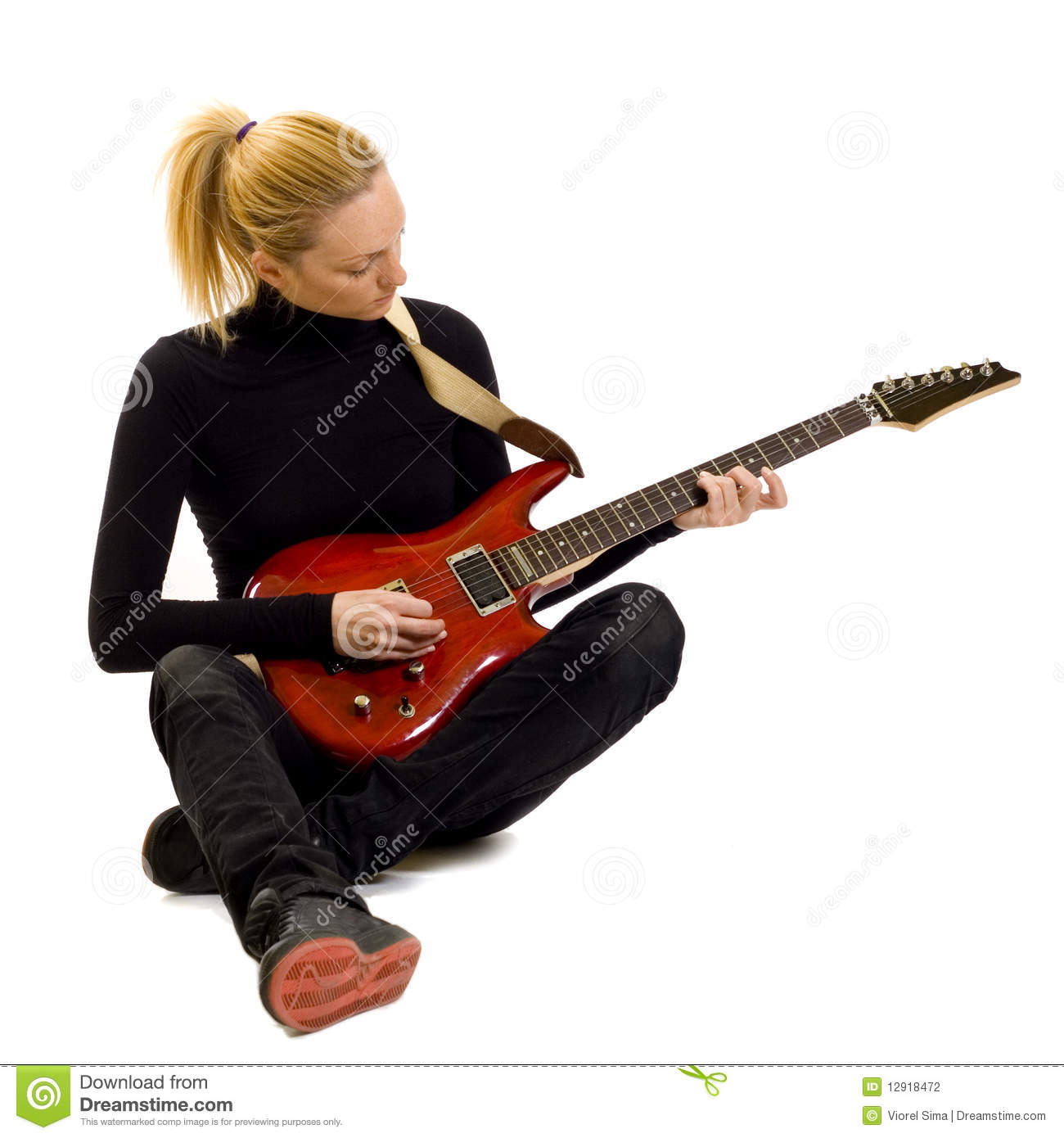 girl playing an electric guitar sitting down stock photo image 12918472. Black Bedroom Furniture Sets. Home Design Ideas