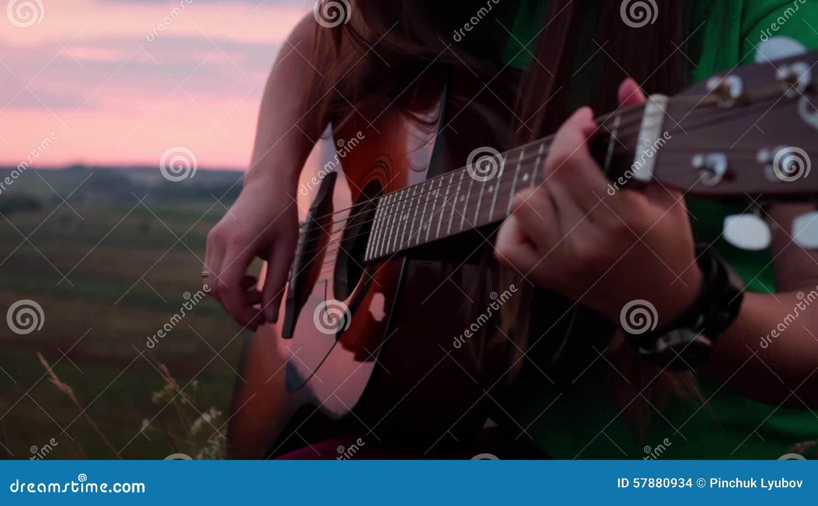 Girl Playing Guitar At Sunset Video Footage 57880934 Megapixl
