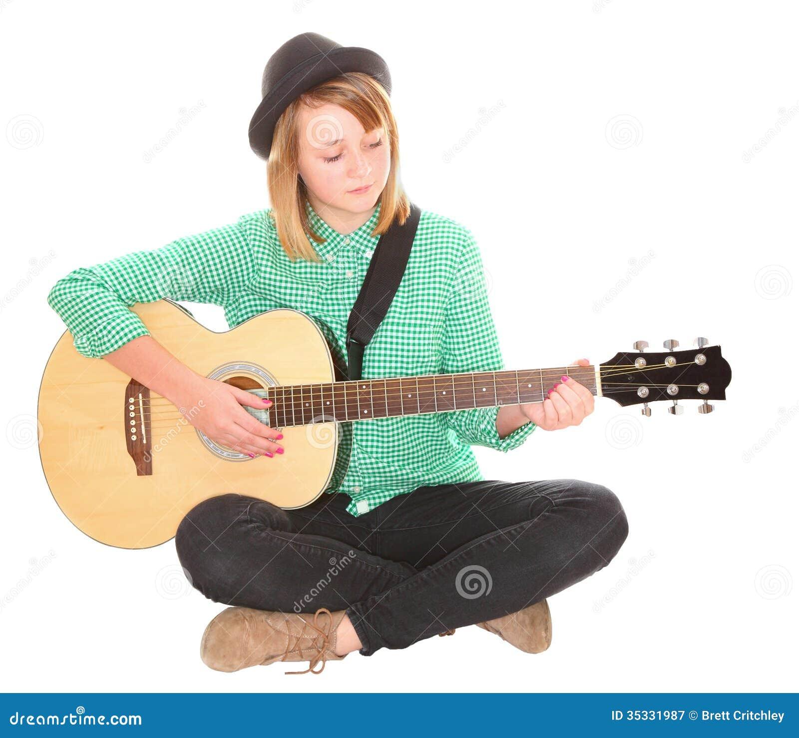 Teen girl musician sit...