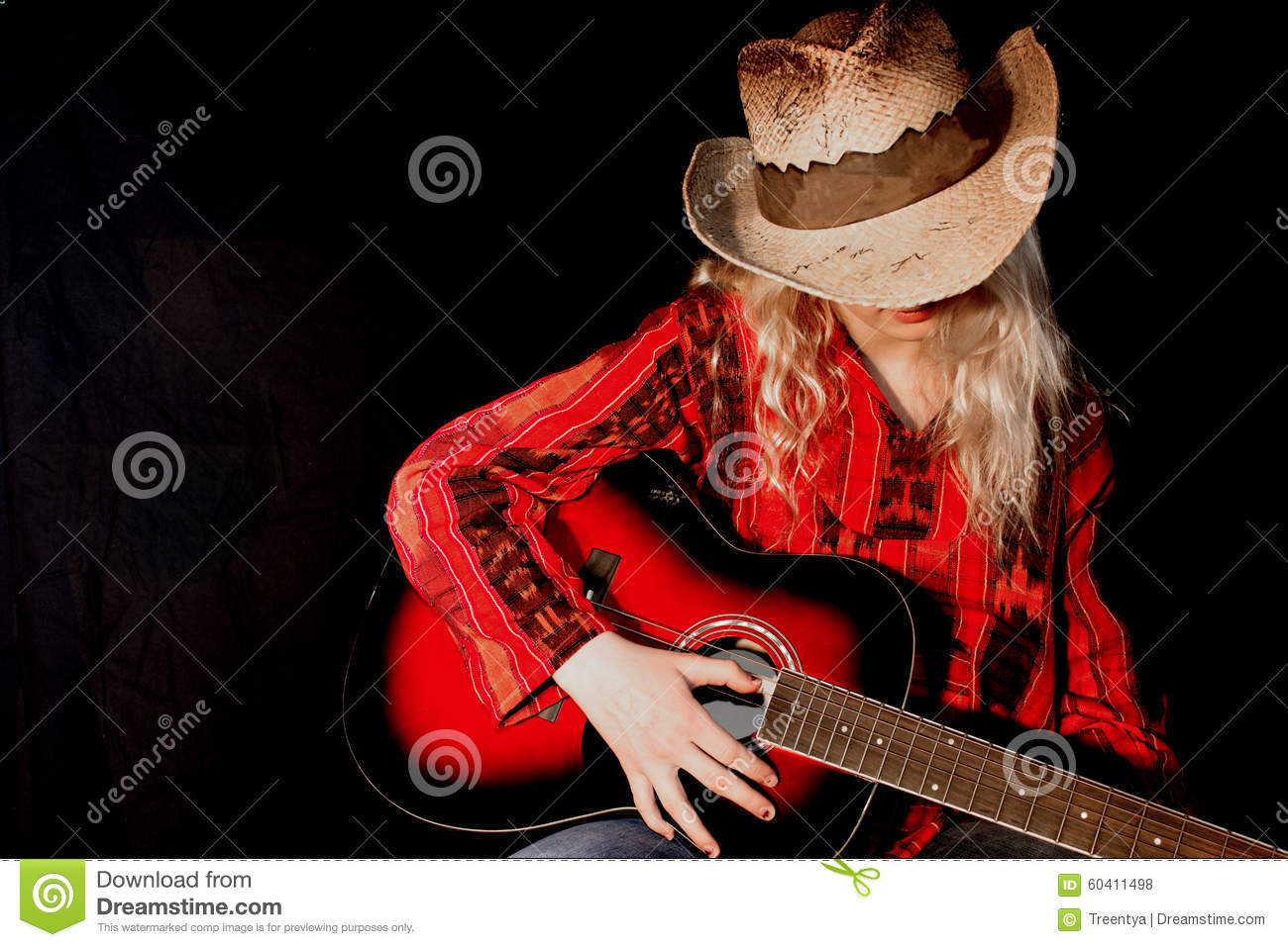 Young girl wearing cowboy hat playing guitar. More similar stock images 17746a57942d