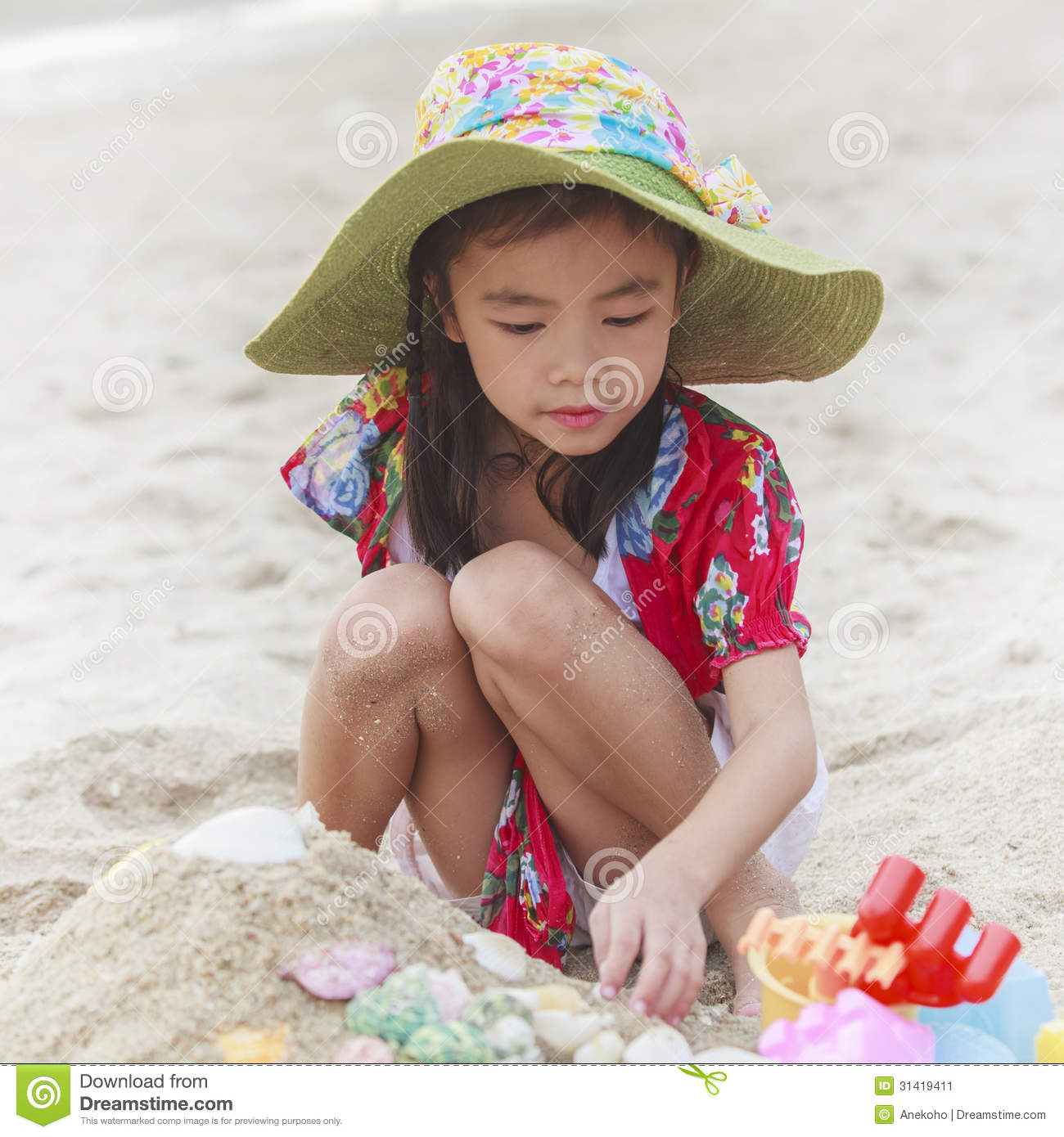 Beach Toys For Girls : Girl is playing with her toys on the beach stock image