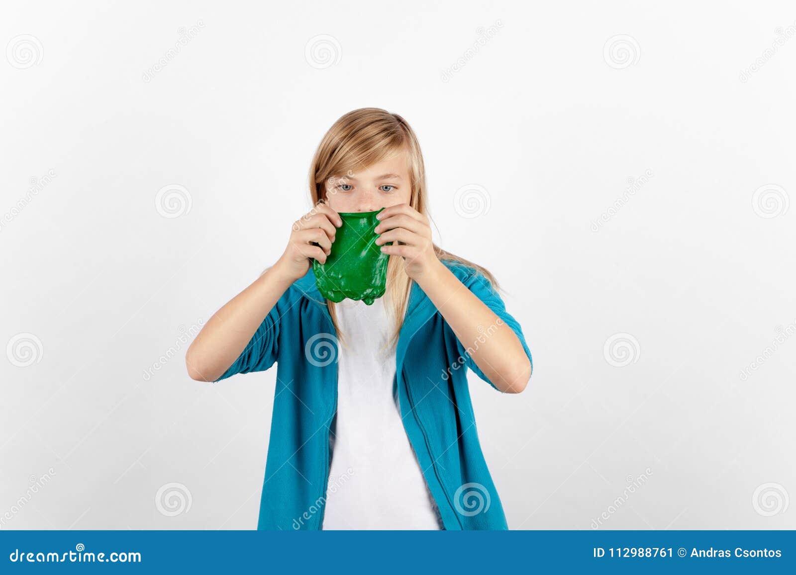 Girl playing with homemade green slime