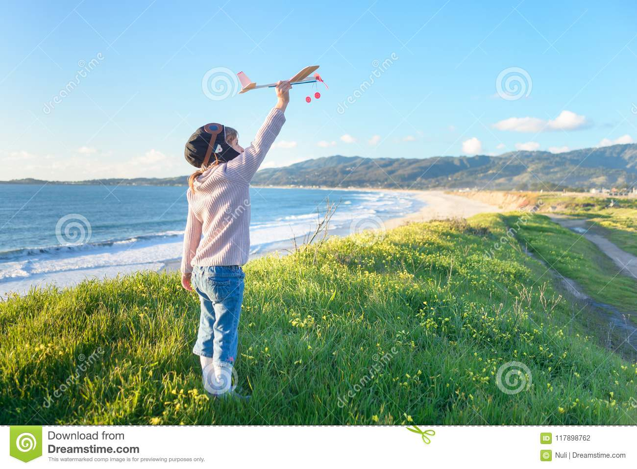 99a48230d0a Girl In Aviator Hat Playing Pilot With Toy Plane Outside Stock Photo ...
