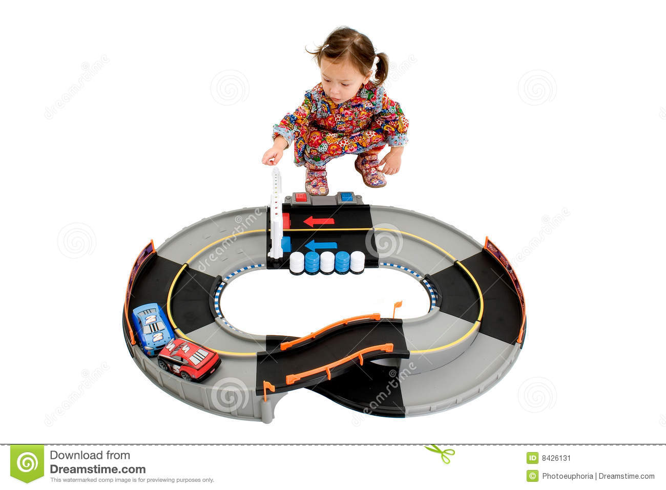 Girl playing with racetrack