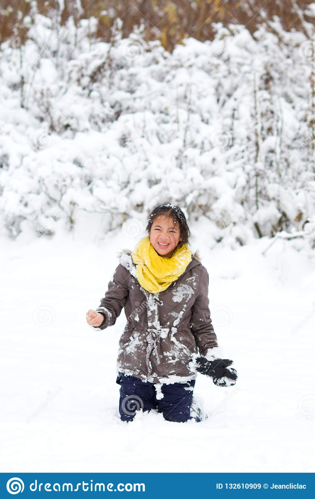 Girl playing in the snow in winter in denmark