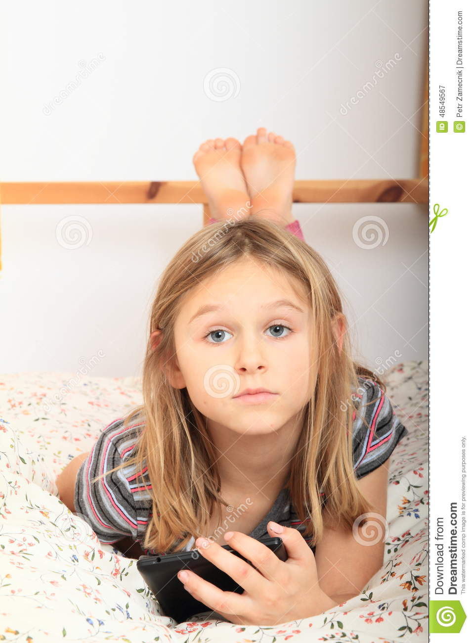 Little Girl Playing In Bed Clipart