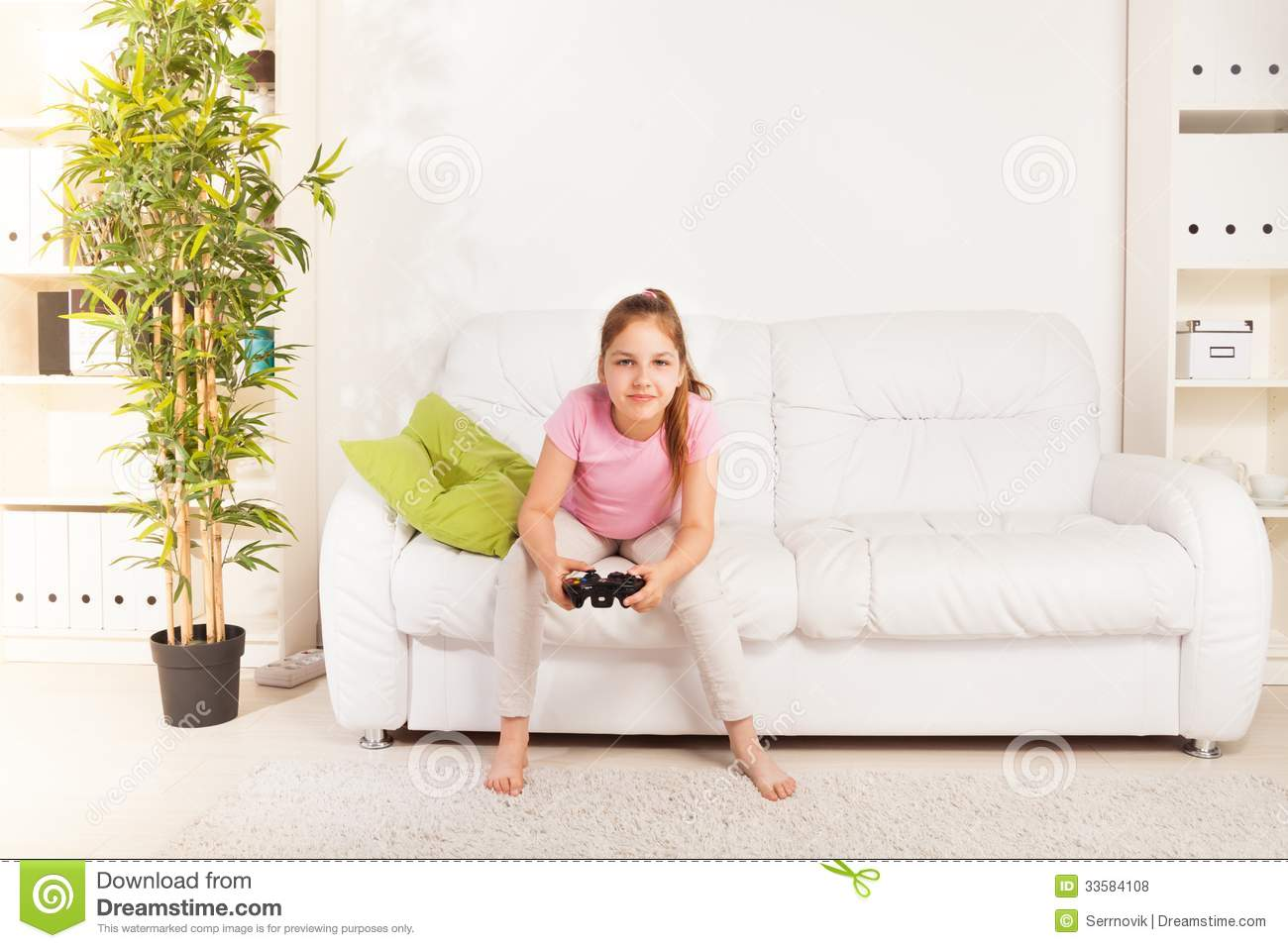 Girl playing videogame stock photo image of equipment for Sitting furniture living room